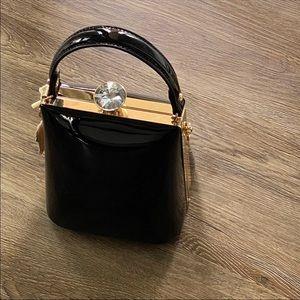 Glossy Black vegan handbag with classy Diamond
